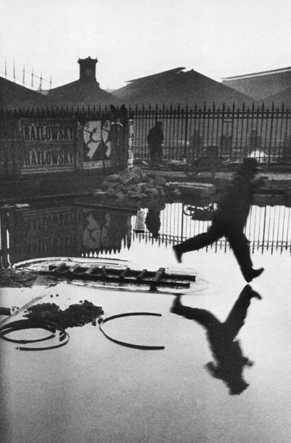 cartier bresson decisive moment man jumping over water