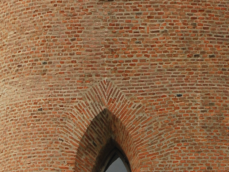Brick Castle Tower With Gothic Windows
