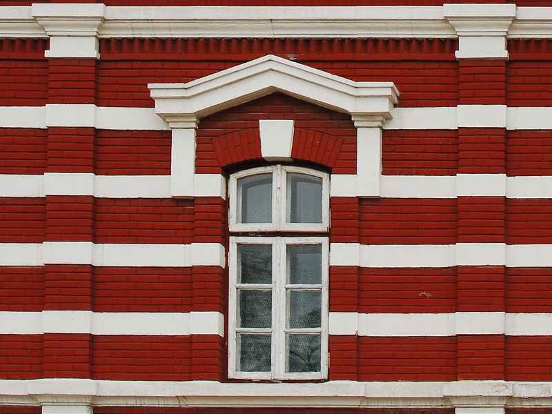 Building Face With Red And White Bricks