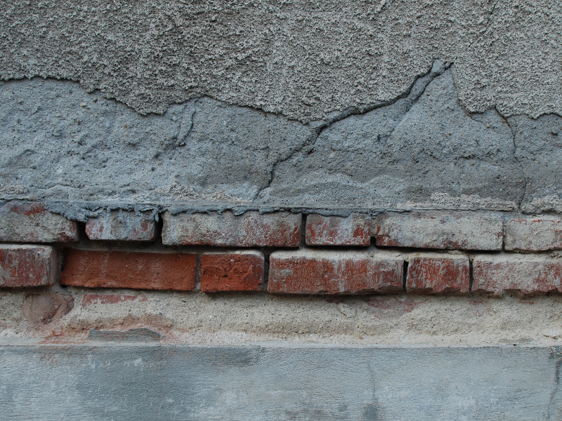 Cracked Wall With Bricks Mortar And Cement