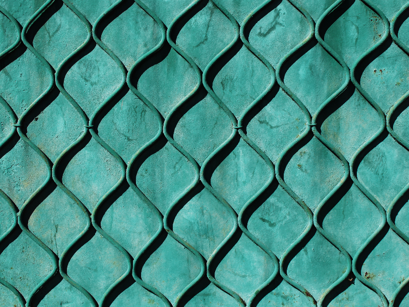 Green Painted Metal Door Texture With Geometric Pattern