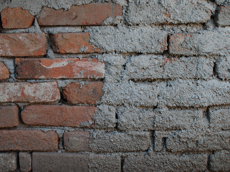 Old Brick Wall With Rough Cement Texture