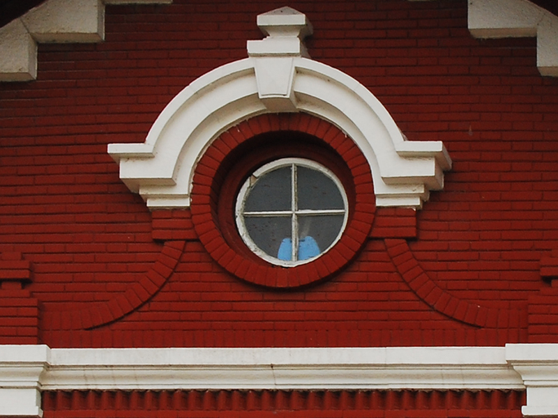 Red Brick White Round Window